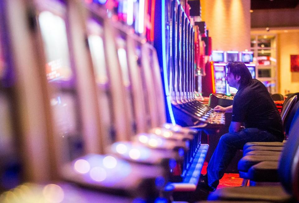 A man played slots at Plainridge Park Casino in Plainville.